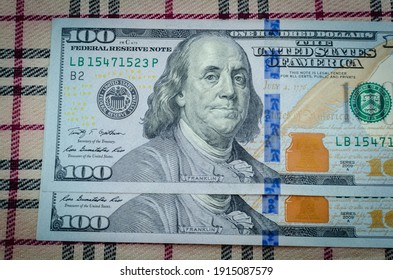 Dollars (bills) on striped material.