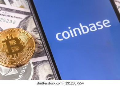 dollars, bitcoin, ethereum and smartphone with Coinbase logo on the screen. Coinbase is a digital currency exchange. Moscow, Russia - February 13, 2019