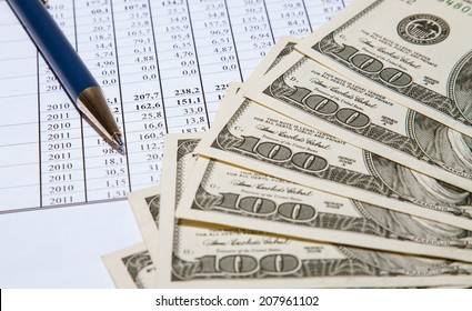 Dollars and blue pen on documents background