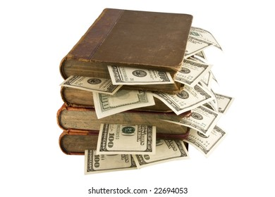 Dollars in the books, isolated on white background