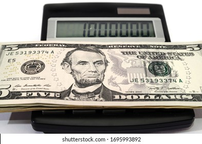 dollars and calculator on white