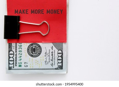 Dollars cash money clip with red note writing MAKE MORE MONEY , concept of earn more extra income from side job or side gig or start business to increase earning - Shutterstock ID 1954995400