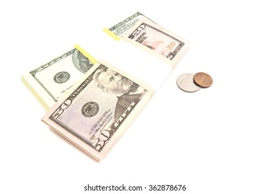 dollars coins and banknotes on white background closeup