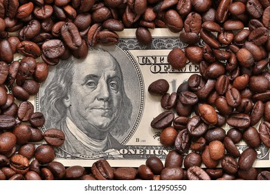 Dollars covered with coffee beans