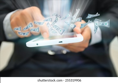 Dollars flying out of the tablet.business concept
