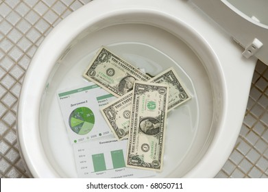 Dollars getting ready to be flushed down the toilet. Photo for  payments, finance, taxes, wasteful spending and any other financial inference