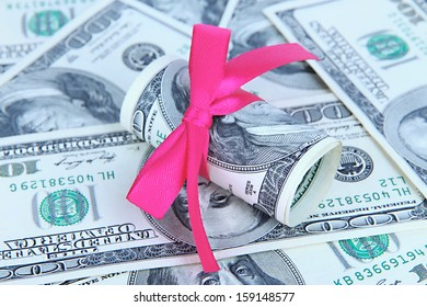 Dollars with gift bow close-up