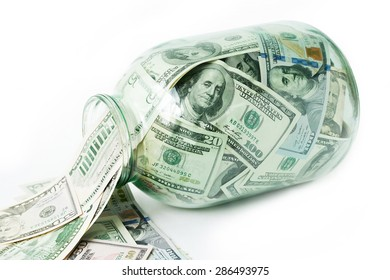Dollars in the glass jar isolated on white background