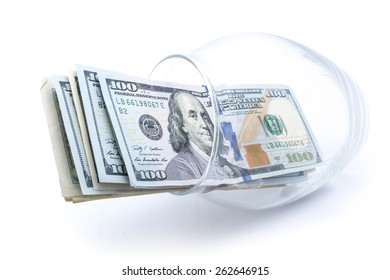 dollars in a glass vase