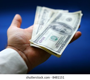 Dollars are in a hand