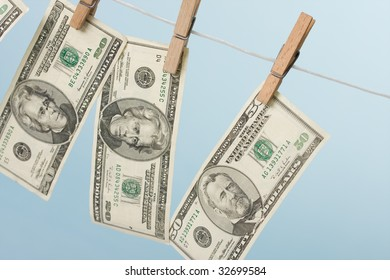 dollars hanging on line on blue background