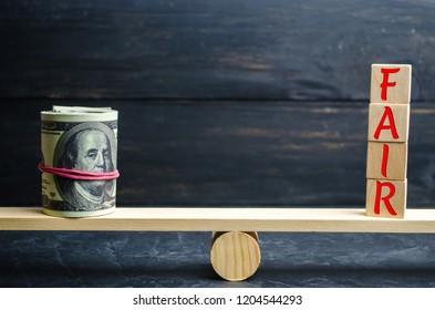 "Dollars and the inscription ""Fair"" on wooden blocks. Balance. Fair value pricing, money debt. Fair deal. Reasonable price. Justified risk."
