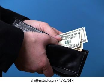 Dollars in man's hands.