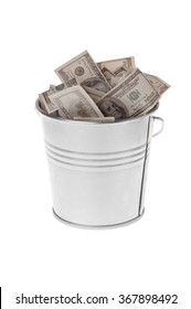 dollars in a metal bucket on a white background