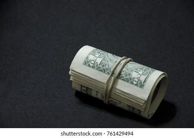 dollars on black background