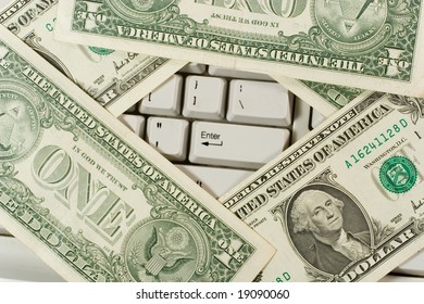 Dollars on the computer keyboard (showing the 'Enter' button)