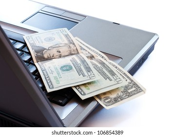 dollars on keyboard
