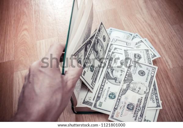 Dollars on open Book