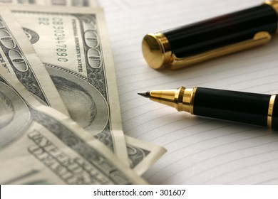 Dollars and pen