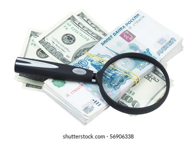 Dollars and roubles and magnifying glass