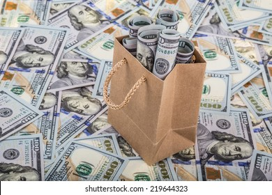 dollars in a shopping bag