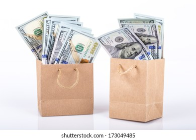 dollars in shopping bags