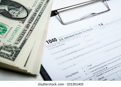 dollars and tax return work close up