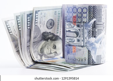 Dollars and tenge. American and Kazakh money on a white background. Isolated.