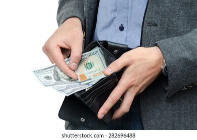dollars and wallet in the hands of men