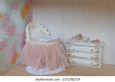 Dollhouse, baby room with crib and bed. Furniture made of wood