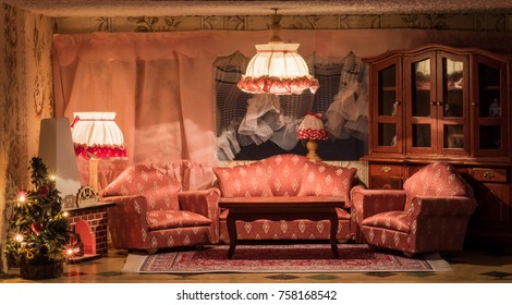 A dollhouse living room at christmas time.
