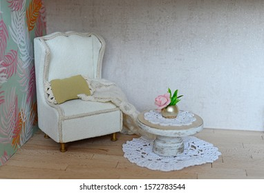 Dollhouse, living room with fireplace, armchair and club table