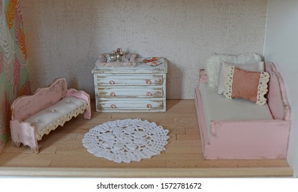 Dollhouse, living room with handmade furniture. Gentle colors for every girl
