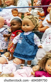 Dolls of collection, for sale and installed on a table in a flea market of Grez sur Loing in department 77. FRANCE - March 2017