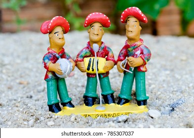 Dolls made of mud to represent local artist of forró from Northeast Brazil.