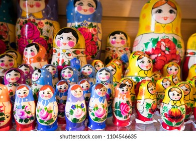 Dolls, Matryoshka Doll, in Gift Shop Shelf. Colorful Set of Various Wooden Stacking Women Figure Dolls in Traditional Old Russian Clothes.