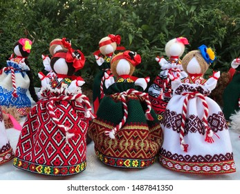 Dolls motanka in colorful dresses. Handmade dolls in colorful clothes.
