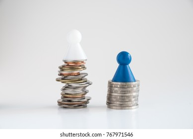 Dolls present men, are top of coin stacks, 1st show unstable, 2nd show stable. Concept risk and secure progress in money investment.