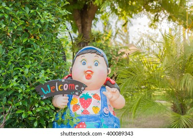Dolls are welcome in the garden.
