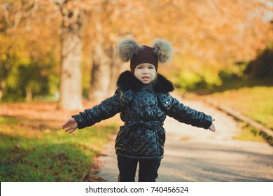 Dolly pin-up toothsome young girl wearing fashion stylish black coat jacket and awesome hat clothes posing in autumn spring park weekend happyly smiling sitting on pathway track.