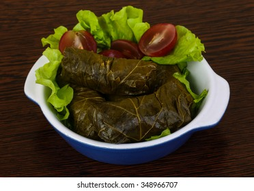 Dolma - minced meat in grape leaves with salad