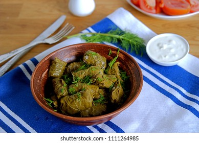 Dolma / Sarma, a traditional Armenian dish in a clay bowl. Served with natural yogurt and garlic sauce
