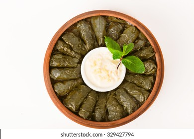 Dolma with sauce on a clay plate for the top menu, isolated, white background top