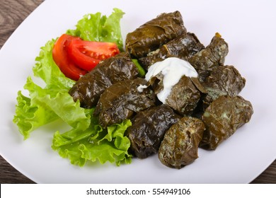 Dolma - stuffed meat in grape leaves with cream sauce