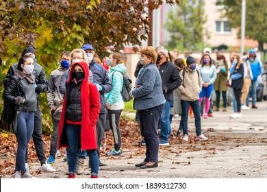 DOLNY KUBIN, SLOVAKIA - OCTOBER 23, 2020:  People in face masks waiting in front of checkpoint for testing for the coronavirus COVID-19