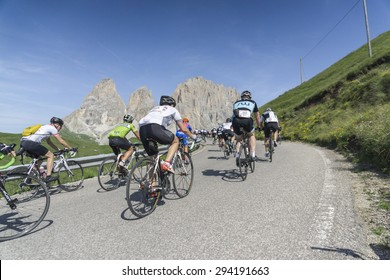 """DOLOMITE ALPS, ITALY-JULY 05, 2015:  Some of the participants of the """"Maratona dles Dolomites"""" bicycle road race in the mountains of the italian Dolomites at the first hours of the race."""