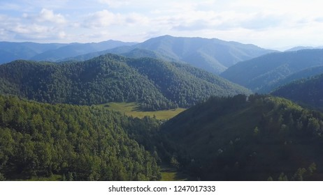 Dolomites alps, amazing panoramic landscape. Clip. Mountain landscape. Colorful Ariege Pyrenees mountains and hills in fall. Aerial shot of green hills at sunrise. Mountains and forest Landscape
