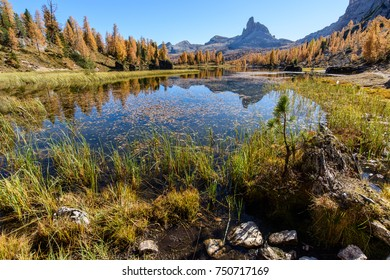 Dolomites. Autumn colors and reflections. The mountain dresses in the fall