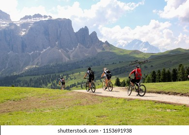 Dolomites, Italy, 20 July 2013 - a group of moutanin bikers are on the high mountain road. Dolomites with its curvy and up-and-down roads is the favorate place for bycling sports.
