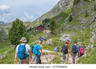 Dolomites, Italy, 2018, July, Hikers on their way to a mountain hut in the Alps